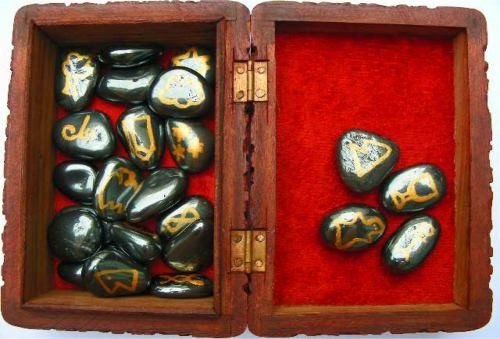 hematite symbol set in a wooden box