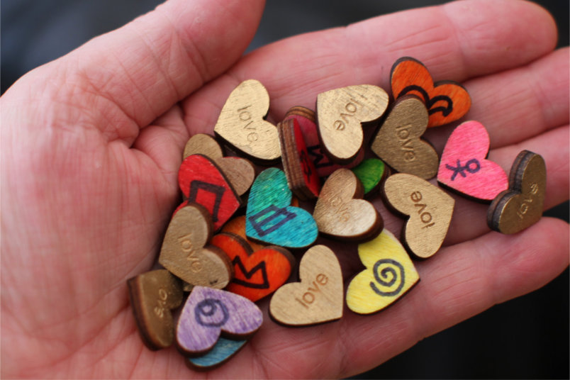 SuperMind Symbols on little wooden hearts